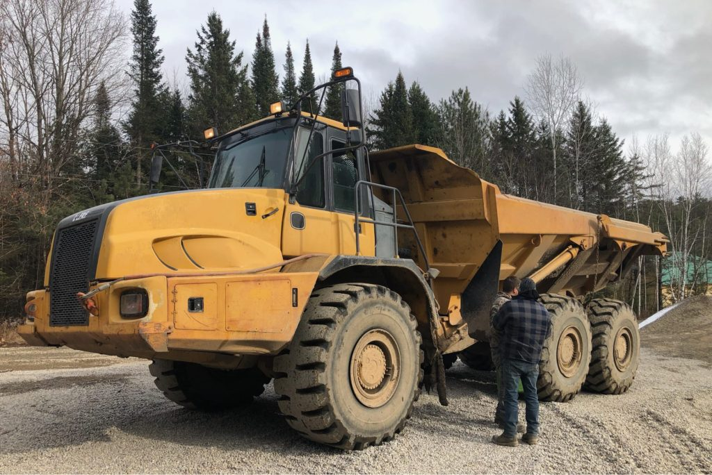 tri-axel articulated dump truck